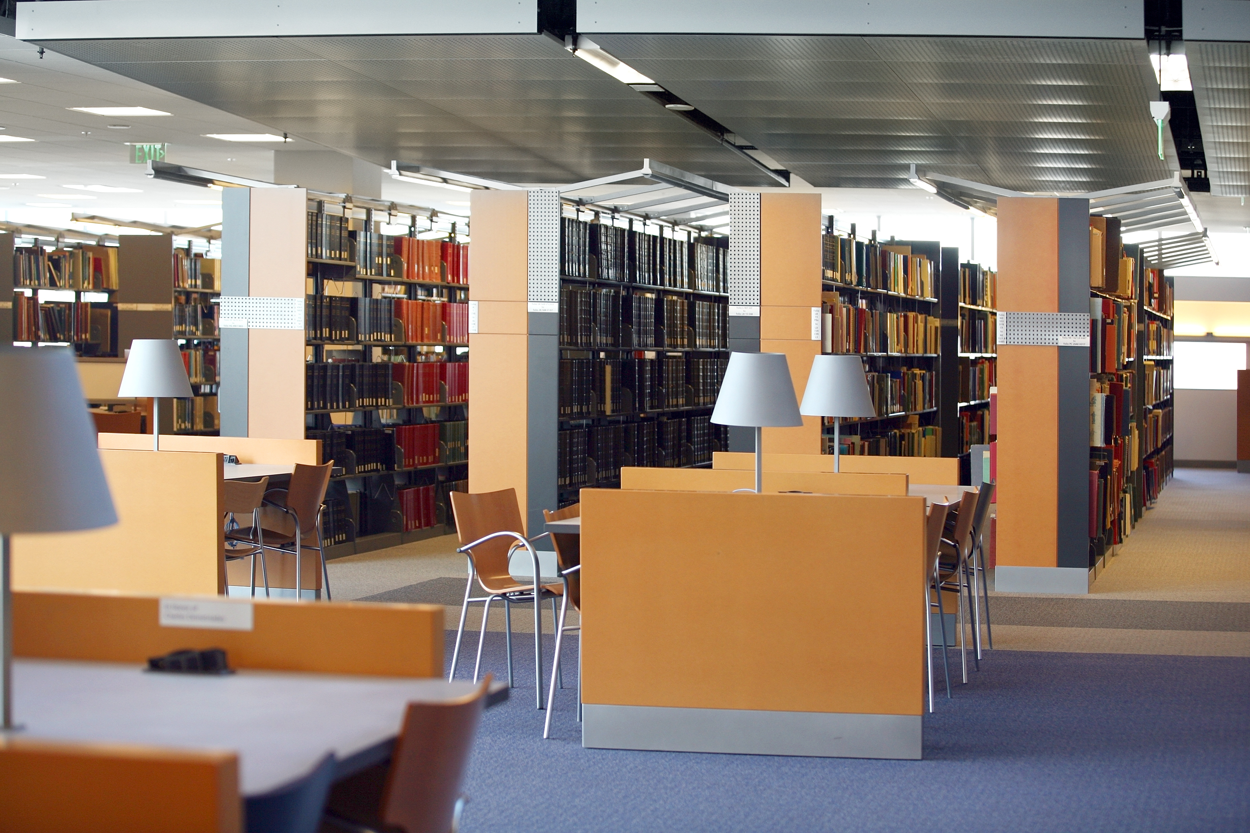 tables and chairs in an empty library